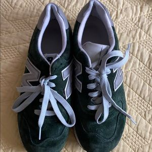 Green new balance sneakers used in jcrew stores